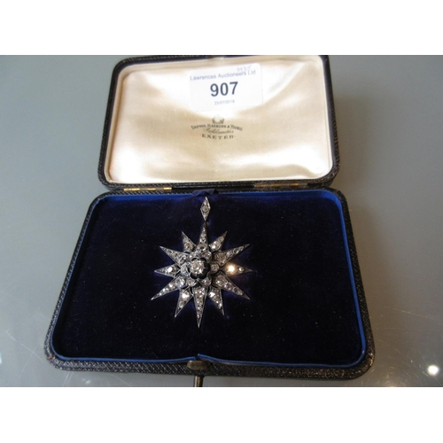 907 - Victorian diamond set star form brooch of approximately 3ct total set old cut diamonds in original b...