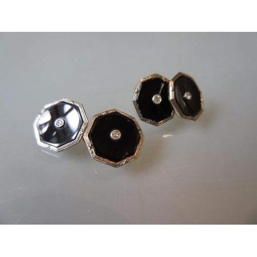 913 - Pair of early 20th Century gold black onyx and diamond set cufflinks...