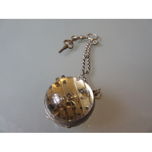 914 - Early 20th Century glass and metal pendant globe watch, the enamel dial with Roman numerals, inscrib...