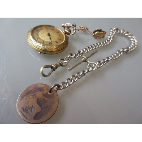 920 - Gold plated floral engraved fob watch and a silver Albert chain...
