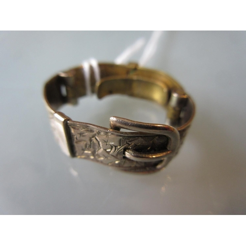 922 - Yellow metal and brass scarf ring in the form of a belt and buckle with engraved front...