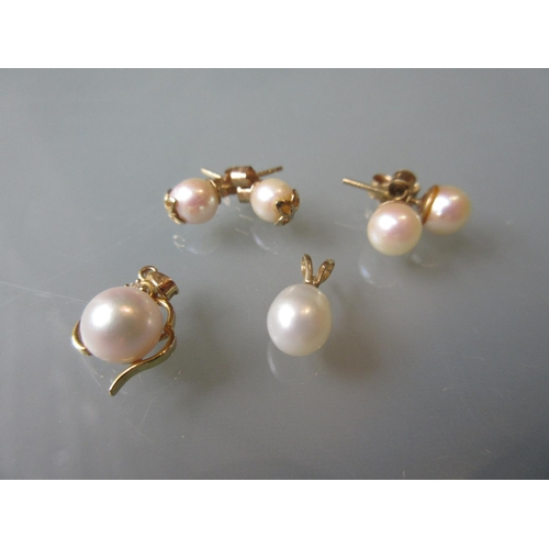 925 - Two pairs of yellow metal pearl set earstuds, two yellow metal pendants, one set pearl and diamond c...