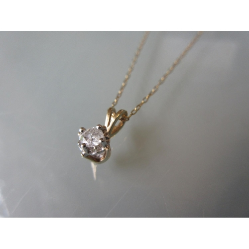 928 - 9ct yellow gold illusion set diamond pendant on chain in fitted box...