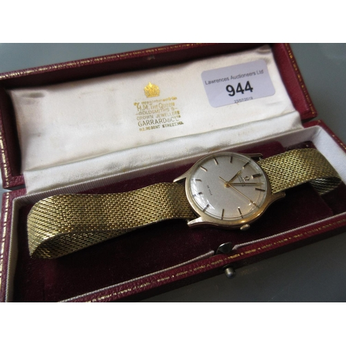 944 - Gents Omega Deville gold cased wristwatch having silvered dial and automatic movement with later str...