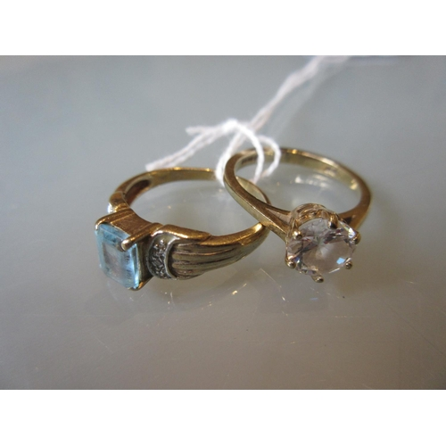 956 - 9ct Gold blue topaz ring and a 9ct gold paste ring...