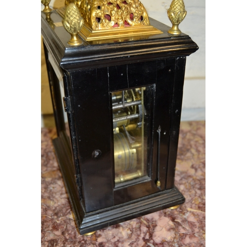 1490 - Small 18th Century ebonised and gilt brass table or bracket clock, the gilt basket top and acorn fin...