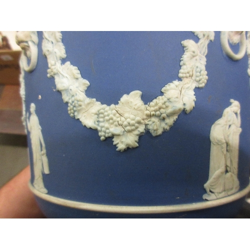 478 - Pair of Wedgwood blue Jasperware jardinieres decorated with classical figures, lion masks and swags ...