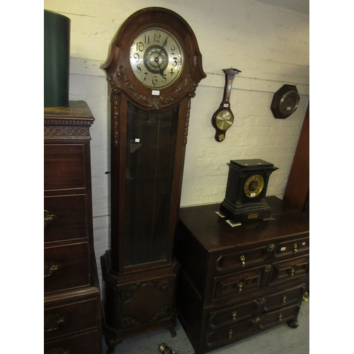 1468A - Early 20th Century oak and walnut longcase clock, the case with carved floral decoration, the circul...