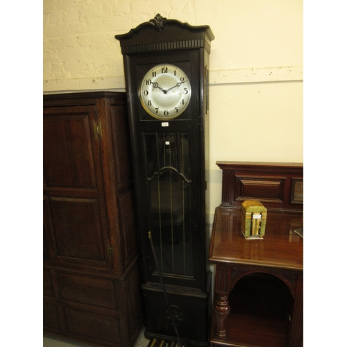 1468C - Early 20th Century oak longcase clock with a bar glazed and bevelled glass door, the circular silver...