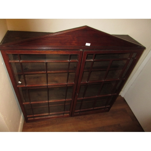 1548C - 19th Century mahogany bookcase top with an arched top above glazed doors...