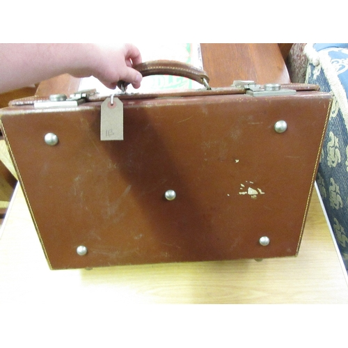 69 - Mid 20th Century Revelation brown leather suitcase...