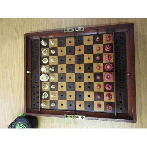 106 - Early 20th Century mahogany cased travelling chess set with natural and red stained bone pieces by J...