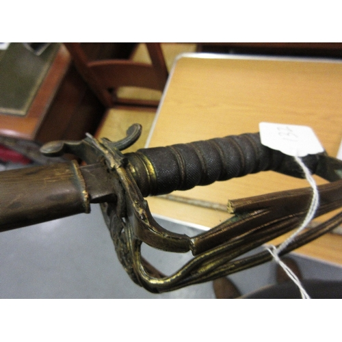 132 - George IV sword with brass hilt and shark skin wire twist grip with leather and brass scabbard (at f...