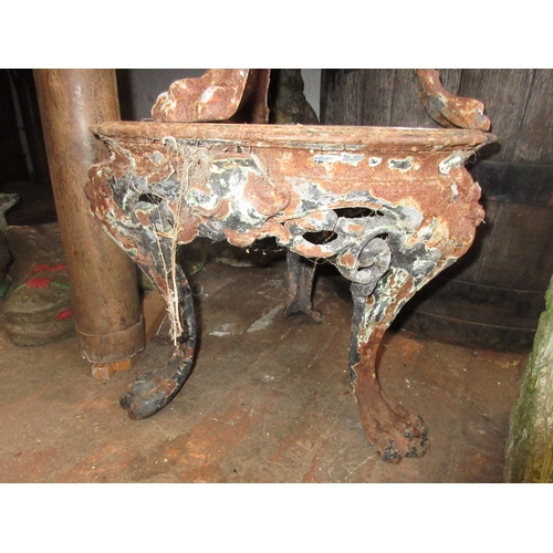 1977 - Two cast iron garden tables on lions paw feet...