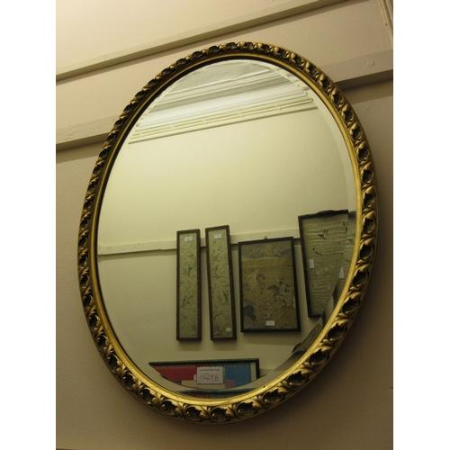 1569B - 20th Century oval gilt framed wall mirror...