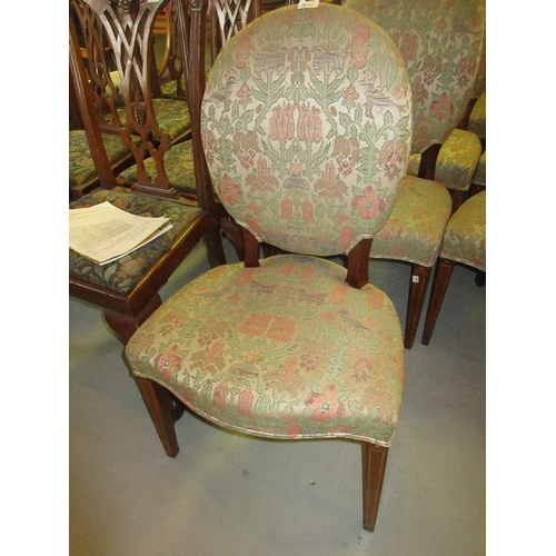 1962 - Set of six George III dining chairs with oval upholstered backs above overstuffed seats, raised on s...