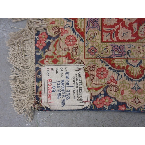 3 - Indo Persian silk rug having central gol with all-over floral design on a wine ground with multiple ...
