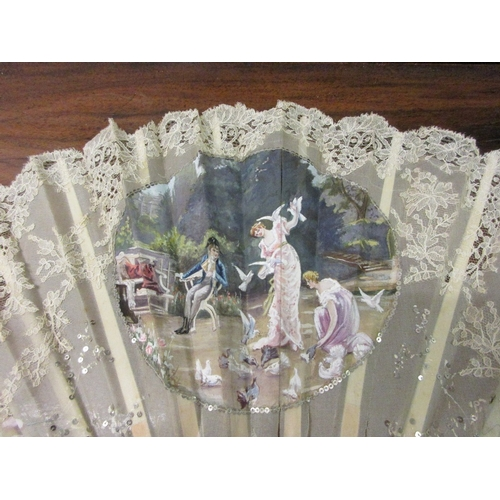 62 - 19th Century French lace work fan painted with figures and birds in a garden scene, housed in a box,...