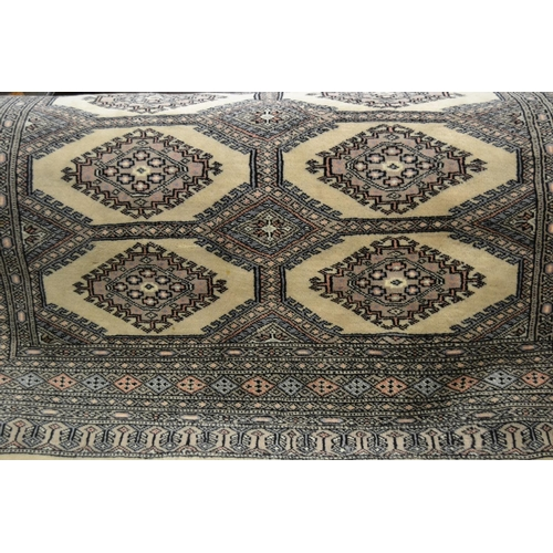 12 - Pakistan rug of Turkoman design, two rows of eight gols on a beige ground with borders, 81ins x 54in...