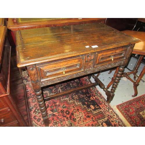 1764 - Oak side table having plank moulded top above two short geometric moulded drawers with brass tear dr...
