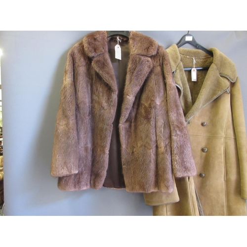 19 - Ladies mid brown fur jacket and a sheepskin coat...