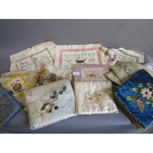 24 - Two World War I sweetheart needle cases, three unframed samplers and other similar textiles...