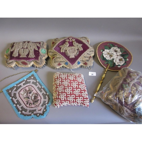 28 - Three early 20th Century bead work pincushions with bird and floral designs on a purple ground toget...