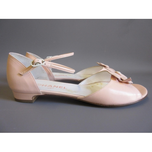 33 - Pair of ladies Chanel pale pink low heeled sandals with four leaf clover to front, complete with ori...