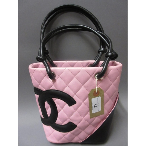 34 - Chanel Cambon Ligne pink and black quilted small tote bag, complete with certificate of authenticity...