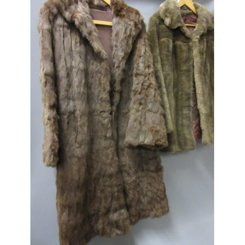 35 - Ladies brown three quarter length fur coat, together with a brown acrylic fur jacket...