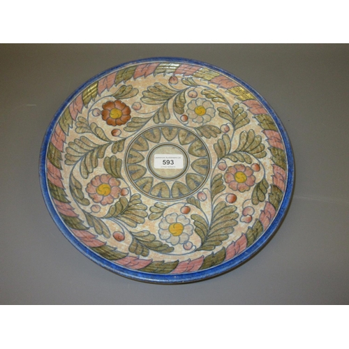 593 - Crown Ducal Charlotte Rhead circular pottery charger with tube lined floral decoration, 12.5ins diam...
