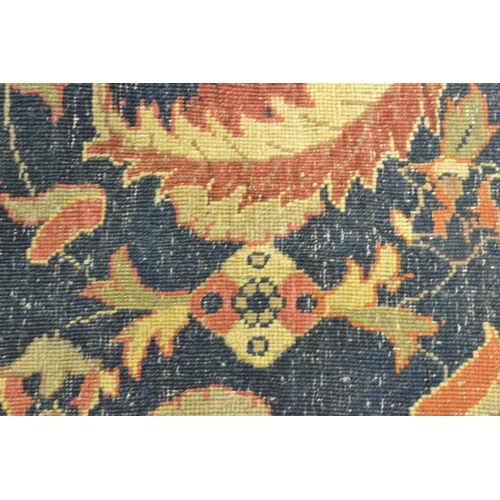 8 - Agra carpet of all-over floral design on a burgundy ground with multiple borders, 116ins x 160ins (w...