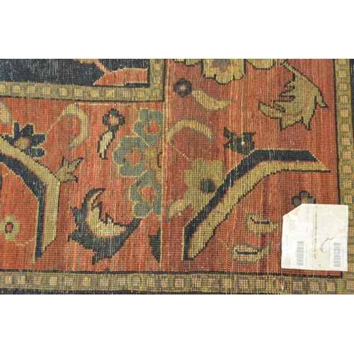 9 - Agra carpet of all-over floral design on burgundy ground with multiple borders, 119ins x 167ins...