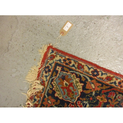 7 - Tabriz rug of all-over floral design with five rows of gols on a wine ground, 56ins x 80ins...