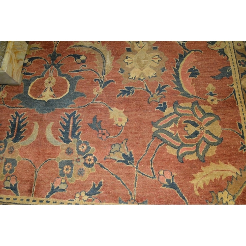 1 - Vyse rug with repeating medallion design in shades of deep red and blue (with damages), 80ins x 64in...