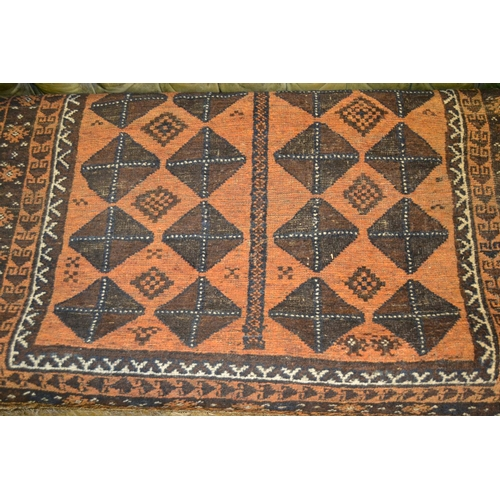 13 - Machine woven rug of Persian design with a blue centre medallion on an ivory ground, 9ft 6ins x 6ft ...