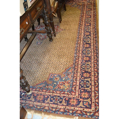 2 - Pakistan rug of Bokhara design with six rows of gols on a salmon pink ground with borders, 10ft x 7f...