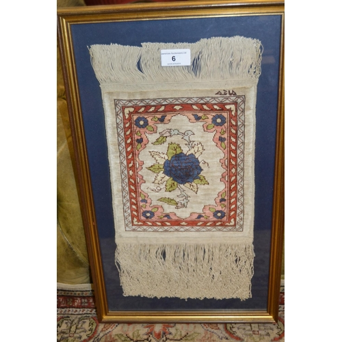 6 - Pakistan rug of Turkoman design with two rows of gols on a rust ground with borders...