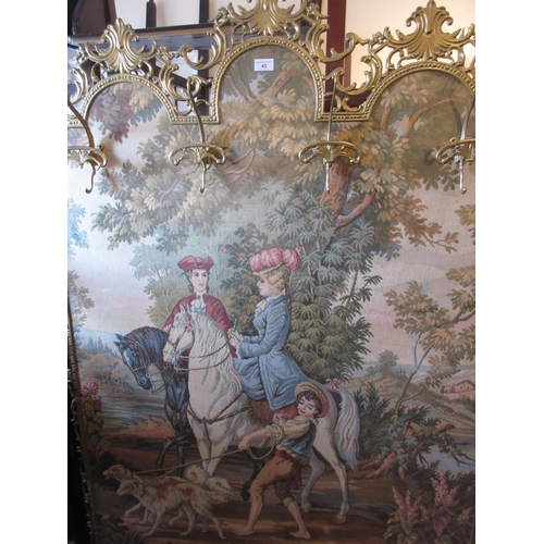 43 - Brass framed floor standing machine woven tapestry of figures on horseback mounted with gilt metal c...