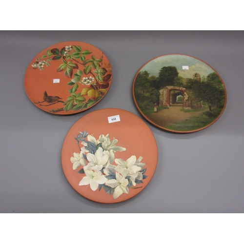 658 - Group of three various Watcombe pottery chargers, one painted with a wren and blackberries, signed R...