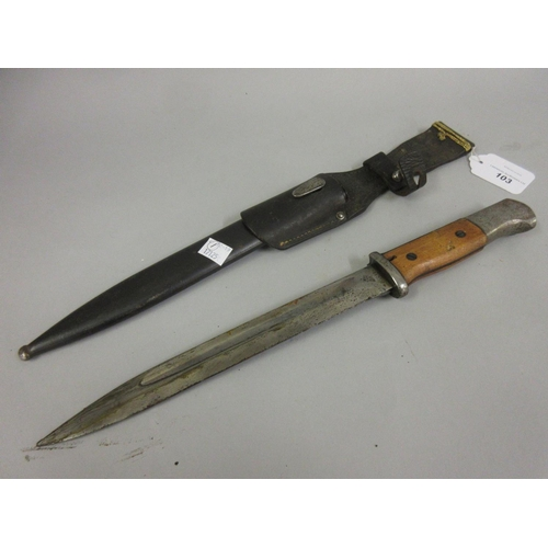 103 - German bayonet with scabbard, the 9.5in blade inscribed 44ASW...