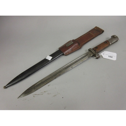 104 - German bayonet with scabbard and leather frog with an 11.5in blade, the scabbard inscribed T.G.F.595...