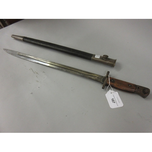 107 - Bayonet with scabbard, the 16.75in blade inscribed 1907 Wilkinson...