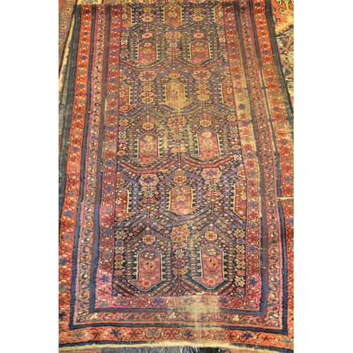 11 - Hamadan runner with a repeating Boteh design on blue ground with borders (worn), 303cms x 89cms...