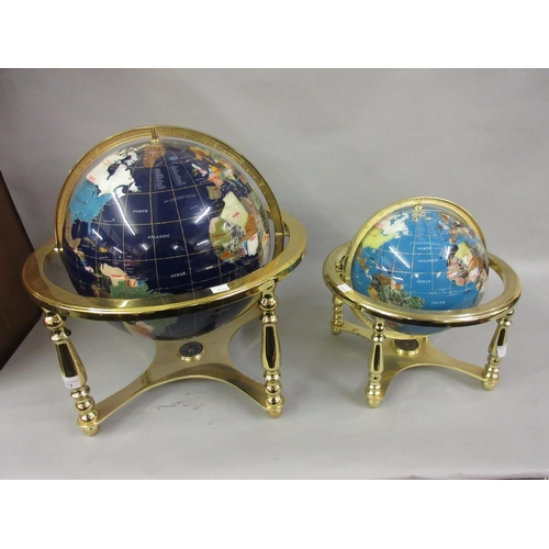 113 - Reproduction globe inset with various minerals on a gilt brass stand together with a similar smaller...