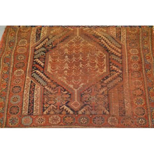 12 - Qashqai rug with twin pole medallion design (worn), 162cms x 109cms...