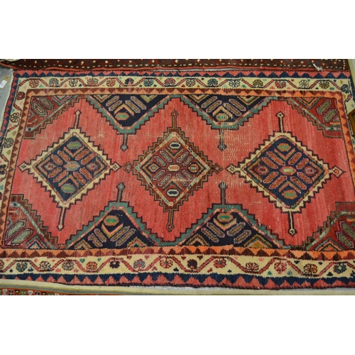 13 - Hamadan rug, triple medallion design on a rose ground with multiple borders and another machine made...