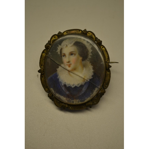 1326 - Portrait miniature of a lady wearing a lace bonnet and ruff collar with blue dress and gilt metal mo...