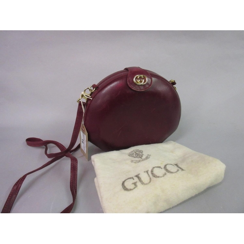 16 - Gucci, burgundy leather ladies shoulder bag with dust cover...