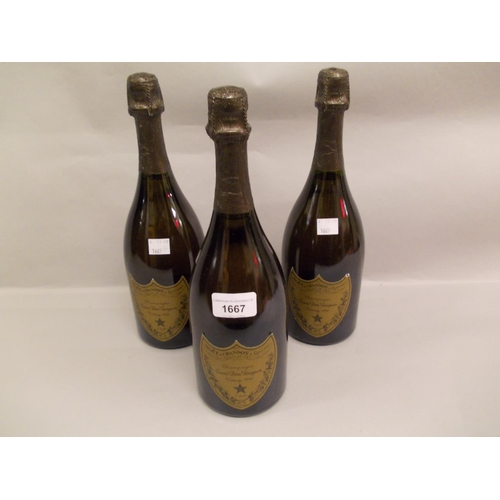 1667 - Three bottles Moet Chandon Dom Perignon champagne 1990